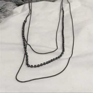 Long black triple cord necklace with stones
